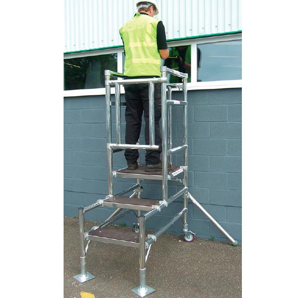 Man on Telescopic podium ladder